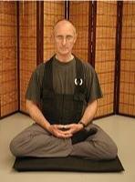 Andy Scott demonstrating half lotus posture
